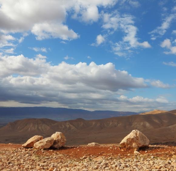 Huge boulders along highway, an unflawed sky