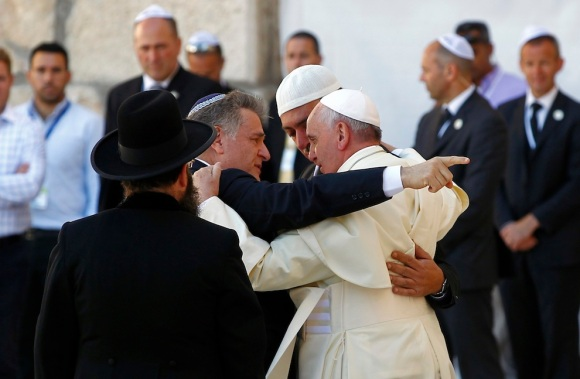 Pope Francis hugs Rabbi Skorka and Abboud, during his visit to the Western Wall in Jerusalem's Old City