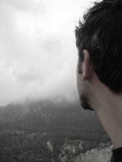 man-looking-into-mountain-haze-flipped